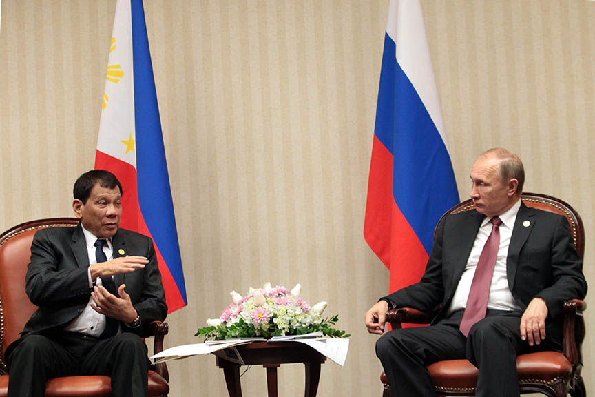 President Rodrigo Duterte and Russian President Vladimir Putin meet for the first time during a bilateral meeting at the sidelines of the Asia-Pacific Economic Cooperation (APEC) Leaders' Meeting in Lima, Peru on November 19. ROBINSON NIÑAL JR./ Presidential Photo