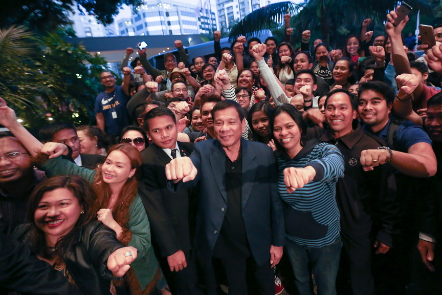 President Rodrigo Duterte poses with members of the Filipino community outside a hotel in Auckland, New Zealand on November 22. Toto Lozano/Presidential Photo