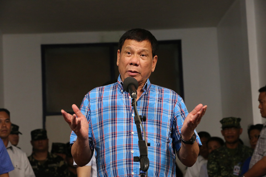 President Rodrigo Roa Duterte announces that while he could order an all-out offensive against the Abu Sayaff, he is more concerned about putting an end to the violence as it also affects the lives of the civilians in his speech during his visit at Camp General Basilio Navarro in Zamboanga City on November 25, 2016. ALBERT ALCAIN/Presidential Photo