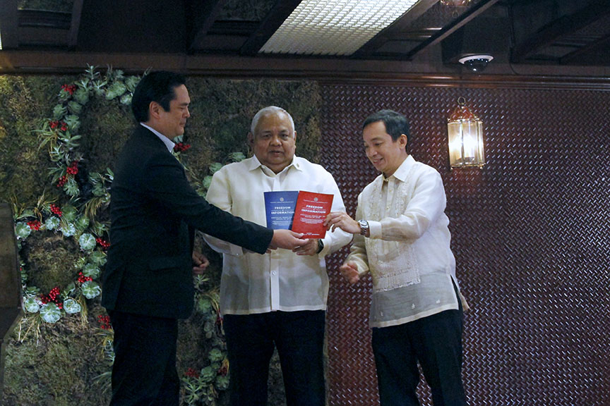 Presidential Communications Secretary Martin Andanar and Executive Secretary Salvador Medialdea hand over the Freedom of Information (FOI) Manuals to Alliance of Concerned Teachers Representative Antonio Tinio during a ceremony at the Heroes Hall in Malacañan on November 25, 2016. ALFRED FRIAS/Presidential Photo