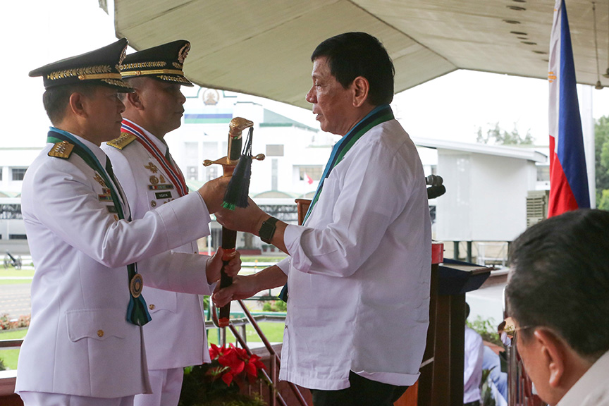 President Rodrigo Roa Duterte hands over the saber to newly-appointed Armed Forces of the Philippines (AFP) Chief of Staff Lieutenant General Eduardo Año during the Change of Command Ceremony at the AFP General Headquarters Grandstand in Camp General Emilio Aguinaldo, Quezon City on December 7, 2016. Also in the Photo is outgoing AFP Chief of Staff Lieutenant General Ricardo Visaya. ALBERT ALCAIN/Presidential Photo