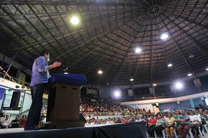 President Rodrigo Roa Duterte delivers a message while leading the gift-giving to the barangay officials in Davao City at the Almendras Gym Davao City Recreation Center on December 27, 2016. ACE MORANDANTE/Presidential Photo