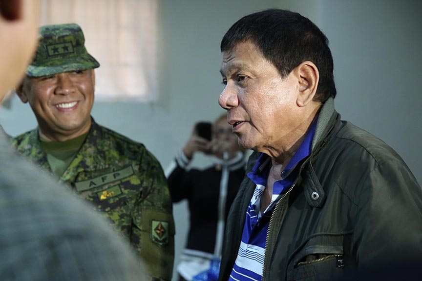 President Rodrigo Roa Duterte shares a light moment with army officials during his visit to the Polymedic Medical Plaza in Kauswagan, Cagayan de Oro City on November 30, 2016. KARL NORMAN ALONZO/Presidential Photo