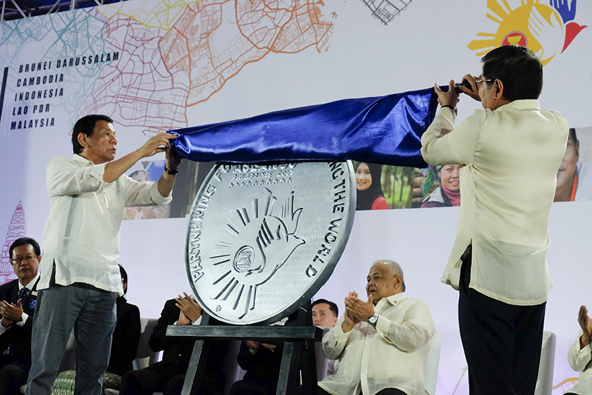 President Rodrigo Roa Duterte and Bangko Sentral ng Pilipinas (BSP) Governor Amando Tetangco Jr. unveil the commemorative coin for the Philippines' Association of Southeast Asian Nations (ASEAN) chairmanship for 2017 during a ceremony at the SMX Convention Center in Davao City on January 15, 2017. RENE LUMAWAG/Presidential Photo