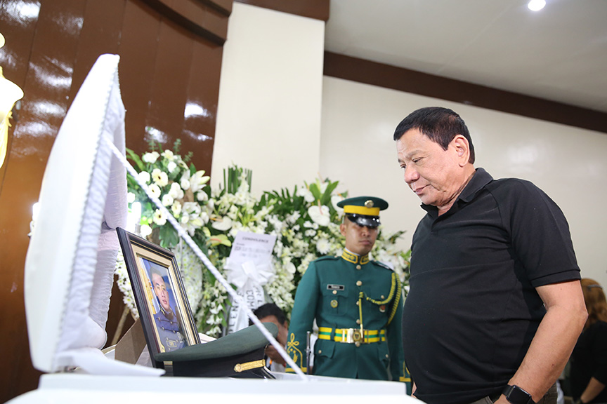 President Rodrigo Duterte visits the wake of the late Captain Clinton Capio at the mortuary of the Libingan ng mga Bayani in Fort Bonifacio on January 16, 2017. Capio, a Philippine Military Academy Class 2006, was killed in a clash with the Abu Sayaff members last Thursday. KING RODRIGUEZ/ Presidential Photos
