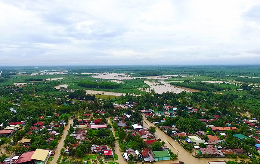 Continuous rains have inundated the town proper of Kapalong in Davao del Norte on Tuesday morning. Photo Courtesy of PTV/ Davao del Norte PIO