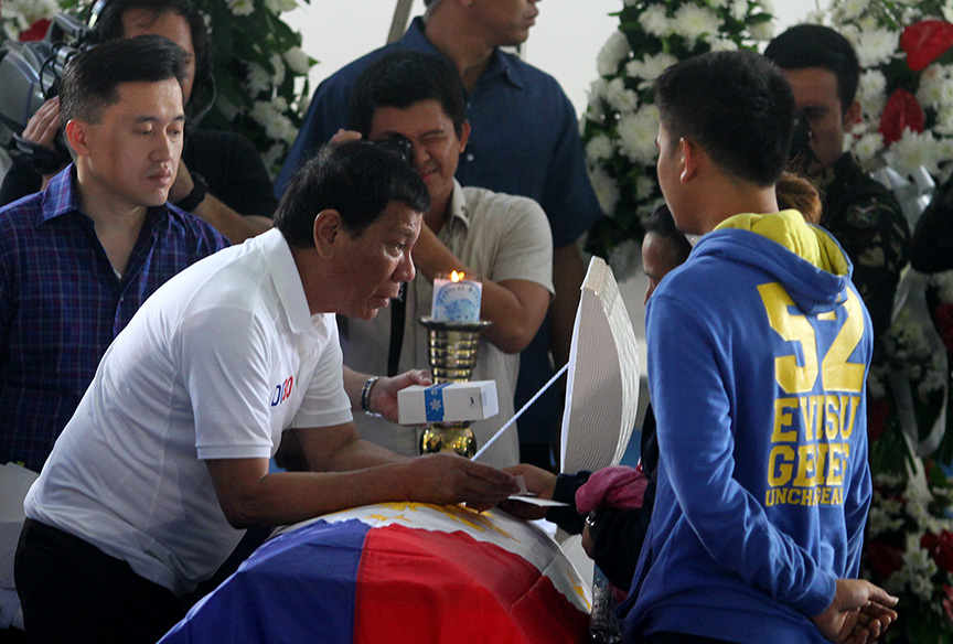 President Rodrigo Duterte condoles with the family of slain Cpl. Michale Yadao at Eastern Mindanao Command headquarters in Davao City on Friday. Yamado and Pvt. Virnin Damondon were killed in an encounter with New People's Army (NPA) rebels in Barangay Lacson in Davao City last February 16. Newsline Photo