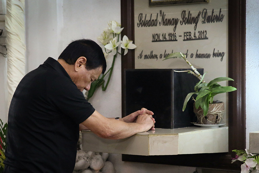 President Rodrigo Roa Duterte spends a solemn moment at the grave of his mother Soledad 'Nanay Soling' Duterte at the Davao Catholic Cemetery to commemorate her death anniversary on February 4, 2017. KARL NORMAN ALONZO/ Presidential Photo