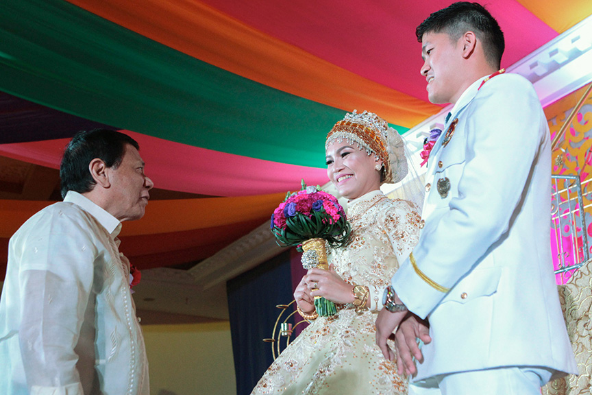 President Rodrigo Roa Duterte extends his well-wishes to the newly-wed couple Senior Inspector Alvin Hosmillo and Senior Inspector Alnieza Kinang-Hosmillo during the reception at the Astoria Regency Convention Center in Zamboanga City on February 12, 2017. The President is one of the principal sponsors for the Kinang-Hosmillo nuptials. The couple caught the public's eye after Hosmillo made a public proposal to Kinang who was among the aide-de-camp of the President during an event at the Police Regional Office 13 sometime in October last year. ALBERT ALCAIN/Presidential Photo