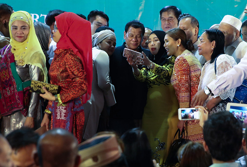 President Rodrigo Roa Duterte grants a photo opportunity with guests during the launch of the Bangsamoro Transition Commission at the Waterfront Insular Hotel in Davao City on February 24, 2017. TOTO LOZANO/Presidential Photo