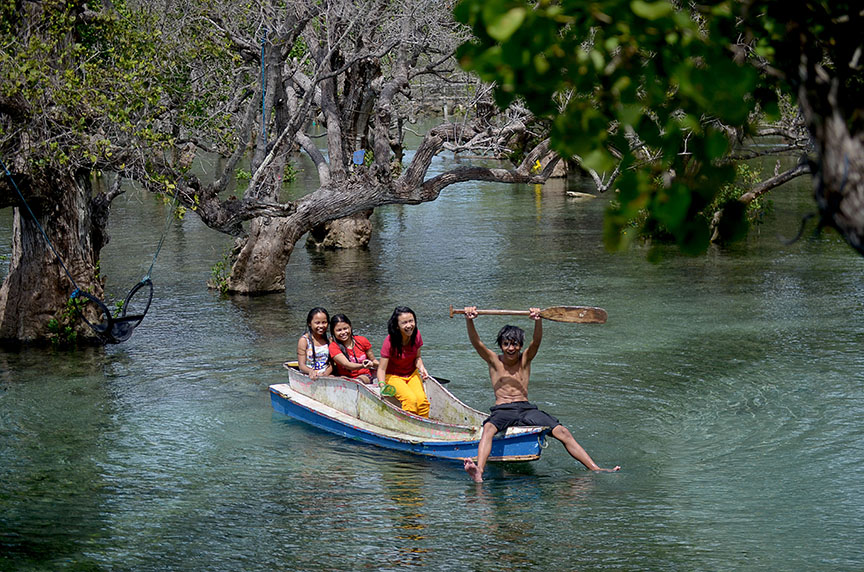 HIDDEN GETAWAY. Local tourists enjoy the crystal clear water under the shades of century-old mangrove trees of Bong Feo resort in Barangay Lago, Glan, Sarangani province during the weekend. Just a 30-minute ride from General Santos City, this mangrove surrounded resort is a perfect getaway for family and backpackers. (Cocoy Sexcion for SARANGANI INFORMATION OFFICE)