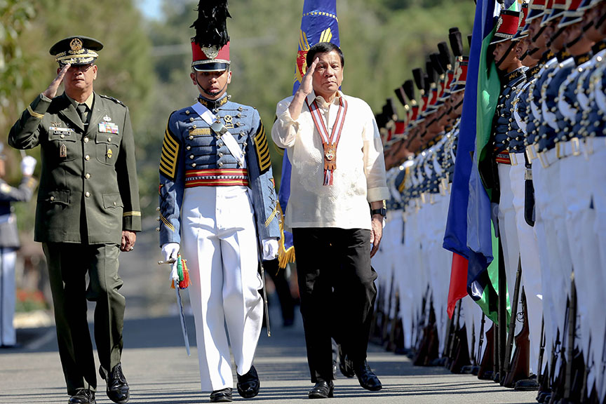 President Rodrigo Roa Duterte is joined by Philippine Military Academy (PMA) Superintendent Lt. Gen. Donato San Juan II as he walks past honor guards upon his arrival at Fort General Gregorio H. del Pilar in Baguio City on March 12, 2017 for the PMA 'Salaknib' Class of 2017 Commencement Exercises. RICHARD MADELO/Presidential Photo