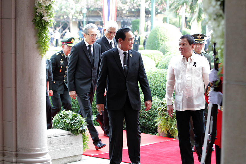 President Rodrigo Roa Duterte is accompanied by Thailand Prime Minister General Prayuth Chan-o-cha as they enter the Thai Koo Fah Building of the Government House in Bangkok, Thailand on March 21, 2017. KING RODRIGUEZ/Presidential Photo