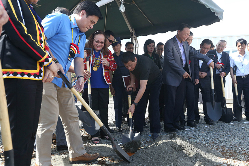 President Rodrigo Roa Duterte is assisted by Senator Juan Miguel Zubiri as he prepares to bury the time capsule during the groundbreaking ceremony of the construction site of the P700 million Drug Abuse Treatment and Rehabilitation Center donated by Friends of the Philippines Foundation (FPF) in Malaybalay City, Bukidnon on March 25, 2017. Also in the photo are Health Secretary Paulyn Ubial (Zubiri's right) and Chinese Ambassador to the Philippines Zhao Jianhua (fifth from right). SIMEON CELI JR./Presidential Photo