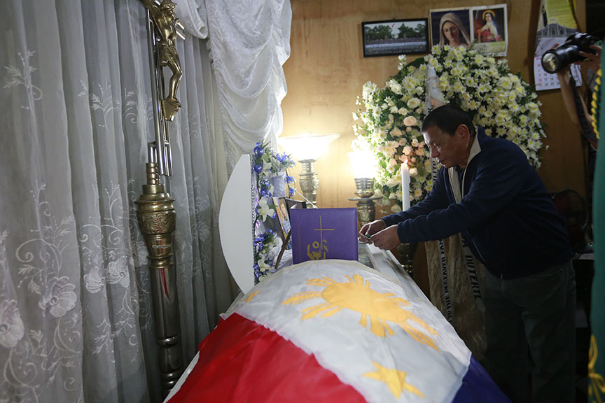 Right after President Rodrigo Roa Duterte's arrival from a successful visit to three countries in the Middle East, he goes straight to the wake of the late 2Lt. Estilito Saldua, Jr. in San Jose, Batangas on April 17, 2017. Here the President awards a posthumous medal to Saldua who was killed while thwarting the terror attack of the Abu Sayyaf Group in Bohol recently. REY BANIQUET/Presidential Photo