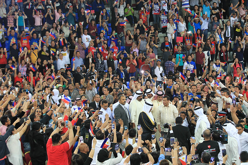 President Rodrigo Roa Duterte is swarmed by supporters upon his arrival at Khalifa Sports City in Bahrain on April 14, 2017 for the meeting with the Filipino community.ACE MORANDANTE/Presidential Photo