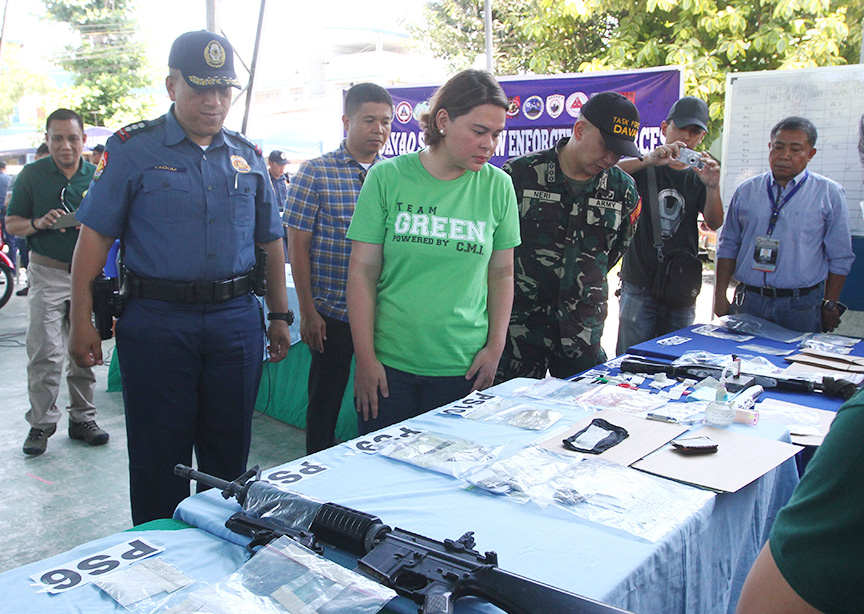 Davao City Mayor Sara Duterte and City Police Director Sr. Supt. Alexander Tagum inspects evidence gathered after a a joint operation on Friday (19 May 2017) of police and military units in 10 barangays in Davao City that targeted drug personalities, wanted persons, illegal firearms and known criminal and terror suspects. Five persons were killed after a firefight with the security forces and at least 65 others were arrested. Newsline Photo