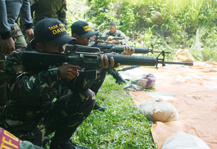 Special Civilian Armed Auxiliary trainees under Task Force Davao undergo marksmanship course as part of their basic military training at an Army camp in Malagos District, Davao City Monday. The Task Force Davao is the Army's counter-terrorism unit in the city. Newsline photo