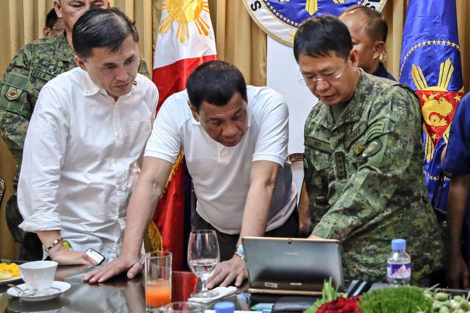 President Rodrigo Roa Duterte views the presentation being showed by Armed Forces of the Philippines chief of staff Gen. Eduardo Año related to the current developments on the terror crisis in Marawi City during a meeting in Davao City on May 29, 2017. With them is Special Assistant to the President, Christopher Bong Go. PRESIDENTIAL PHOTO