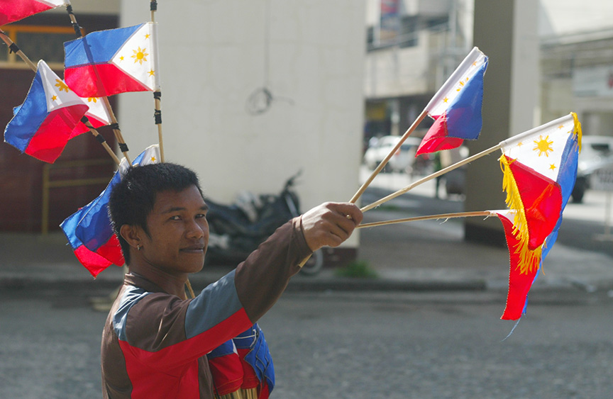 A vendor sells miniature flags along the street in Davao City in time of the 119th Independence Day celebration on Monday, June 12. Newsline Photo