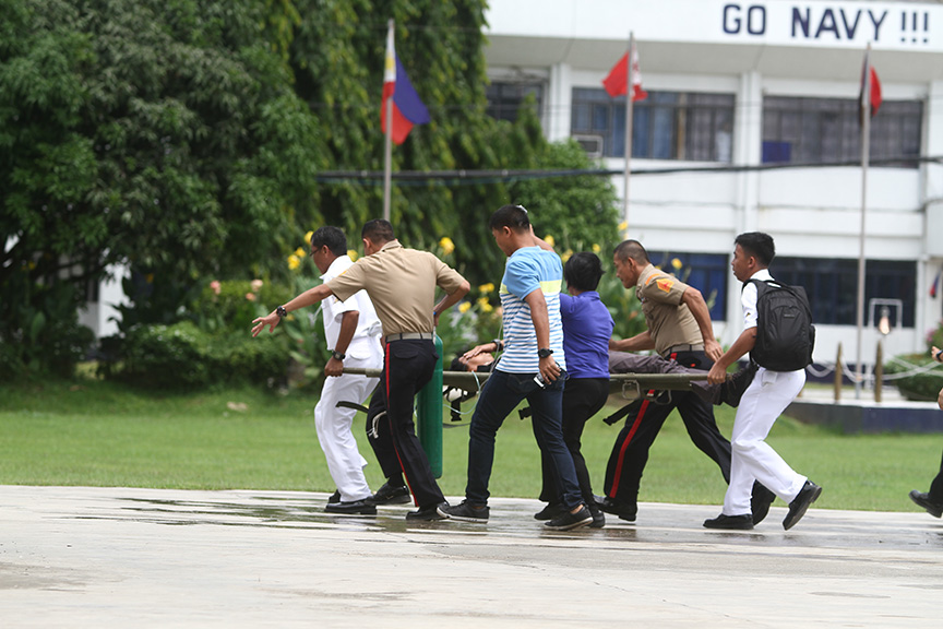 RUSHING: A PSG personnel brought to Camp Panacan Hospital after the New People's Army rebels ambushed their convoy along the Davao-Botabato-Bukidnon highway Wednesday morning. Newsline Photo